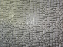Chapa fabricada em aÇo maciÇo e gravada químicamente para estampar pele bovina e sintéticos.